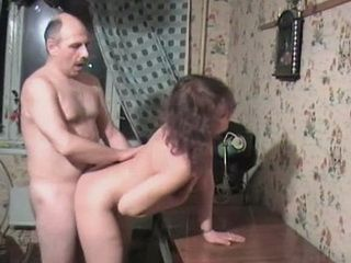 Elder Guy Banging His Younger Wife On The Table In The Livnig Room