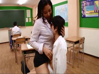 Busty Teacher Took One Of The Students Out Of A Classroom And Gave Him A Blowjob And Titjob While Others Were Taking Tes